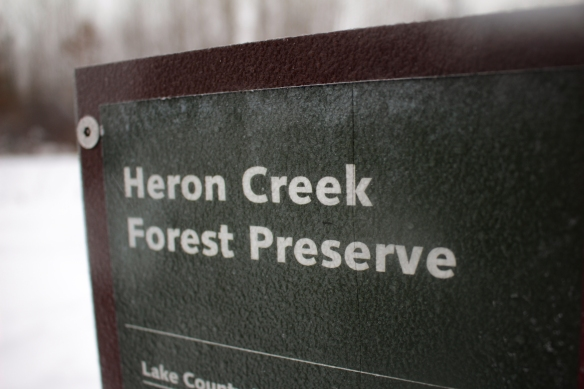 The title of a navigational sign painted over with ice. Photo © Lake County Forest Preserves.