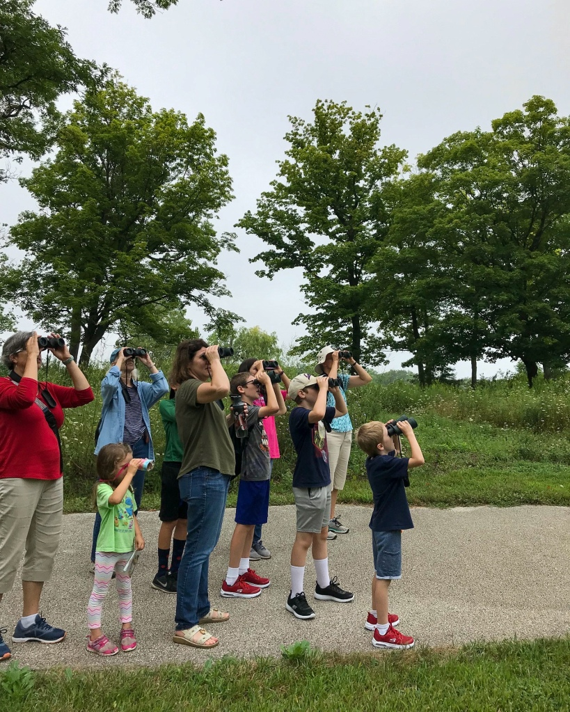 A group of preserve visitors watches for birds. Photo © Lake County Forest Preserves.